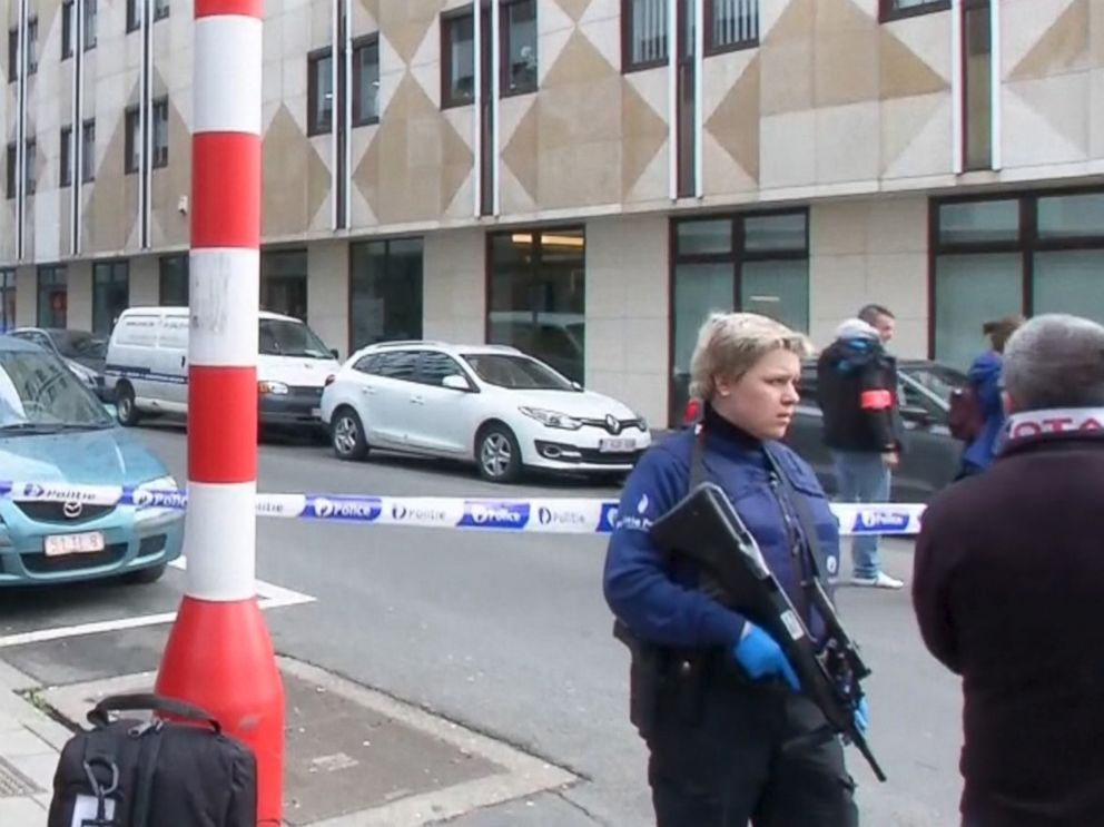 PHOTO: Emergency personnel are seen at the scene of a blast outside a metro station in Brussels, in this still image taken from video on March 22, 2016.