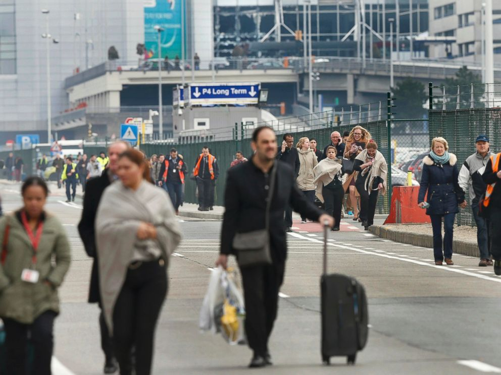 PHOTO: People leave the scene of explosions at Zaventem airport near Brussels, Belgium, March 22, 2016.