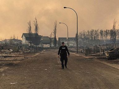 Photos:  Wildfire Forces Evacuation of Canadian City
