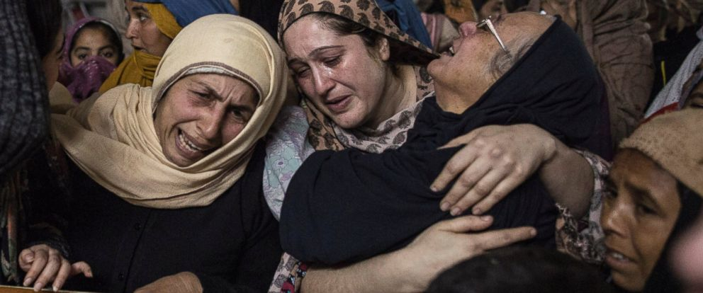 PHOTO: Women mourn for a student who was killed during an attack by Taliban gunmen on the Army Public School, at his house in Peshawar on Dec. 16, 2014.