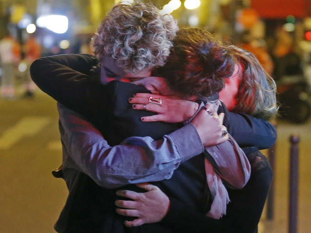PHOTO: People hug on the street near the Bataclan concert hall following fatal attacks in Paris, Nov. 14, 2015.