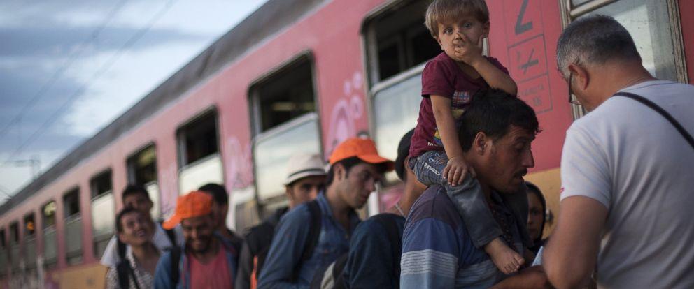 PHOTO: Migrants board a train after crossing the Macedonian-Greek border near Gevgelija, Macedonia, Sept. 6, 2015.