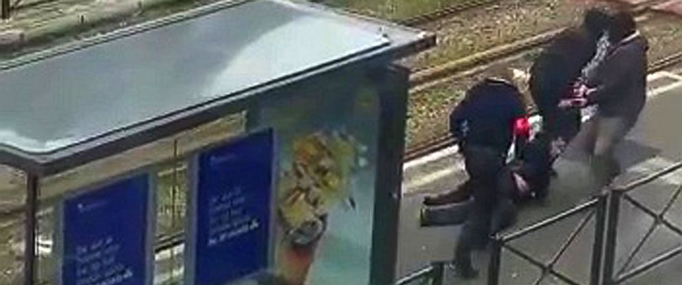 PHOTO: Belgian police drag a man along a rail platform in this still image taken from amateur video in the Brussels borough of Schaerbeek, Belgium, March 25, 2016.