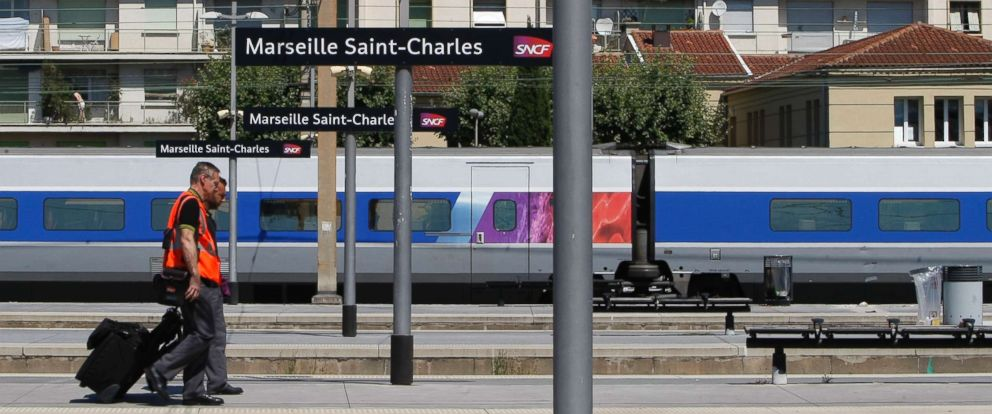 PHOTO: French rail employees SNCF walk along a platform in Saint-Charles railway station, Marseille, southern France, June 19, 2014.