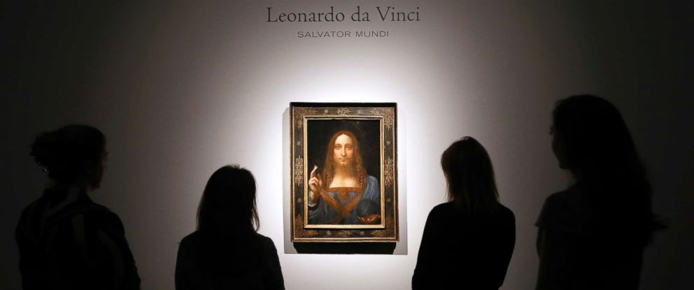 "PHOTO: People gather around Leonardo da Vincis ""Salvator Mundi"" on display at Christies auction rooms in London, Oct. 24, 2017."