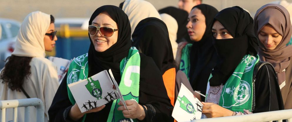 PHOTO: Female Saudi supporters of Al-Ahli queue at an entrance for families and women at the King Abdullah Sports City in Jeddah, Jan. 12, 2018, ahead of their teams football match against Al-Batin in the Saudi Pro League.