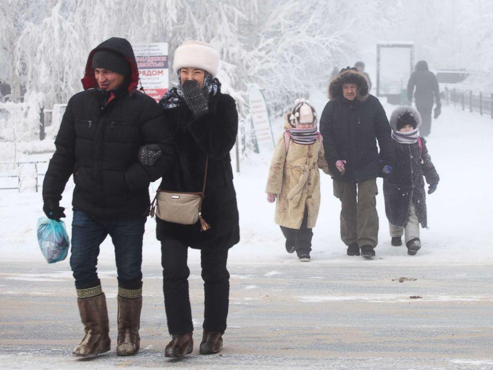 PHOTO: Local residents walk along a city street in Yakutsk, Russia, Jan. 16, 2018.