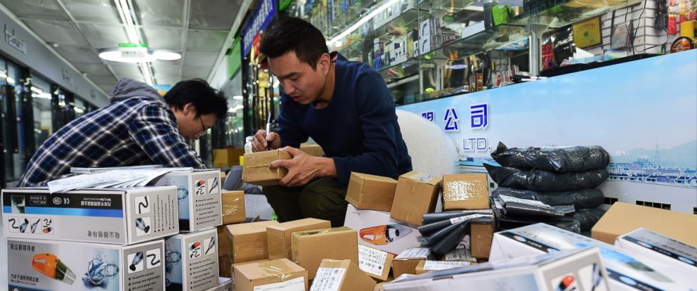 PHOTO: Staff members of an e-commerce company package products in Yiwu, east Chinas Zhejiang Province, Nov. 8, 2017.