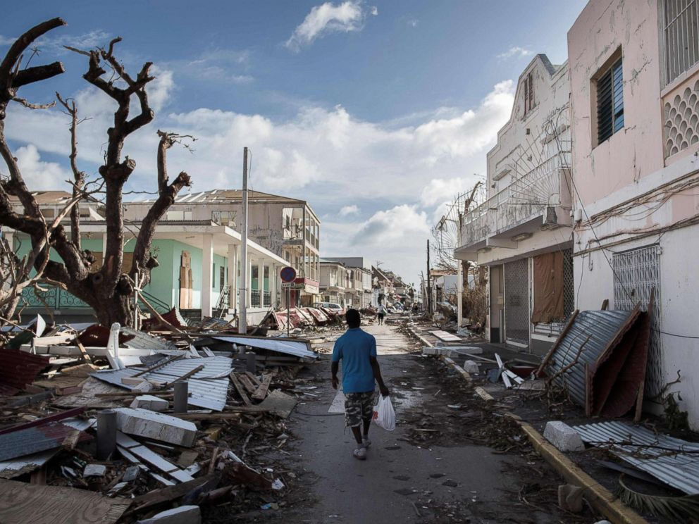 PHOTO: A man walks on a street covered in debris after hurricane Irma hurricane passed on the French island of Saint-Martin, near Marigot, Sept. 8, 2017.