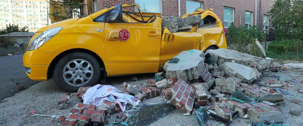 PHOTO: A 5.4-magnitude earthquake damaged a car by falling bricks in the southeastern port city of Pohang, Nov. 15, 2017.