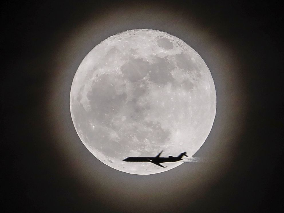 Erik S. Lesser  EPAAn airplane crosses in front of the moon a supermoon in Avondale Estates Georgia Dec.3 2017