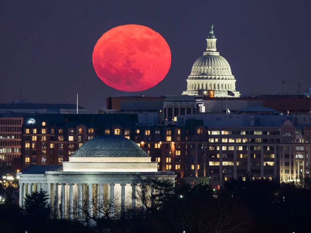 PHOTO: A supermoon rises behind the US Capitol and the Jefferson Memorial, in Washington, DC, viewed from Arlington, Virginia, Dec. 3, 2017.