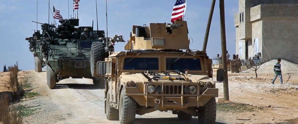 PHOTO: This Tuesday, March 7, 2017 frame grab from video provided by Arab 24 network, shows U.S. forces patrol in al-Asaliyah village, Aleppo province, Syria.