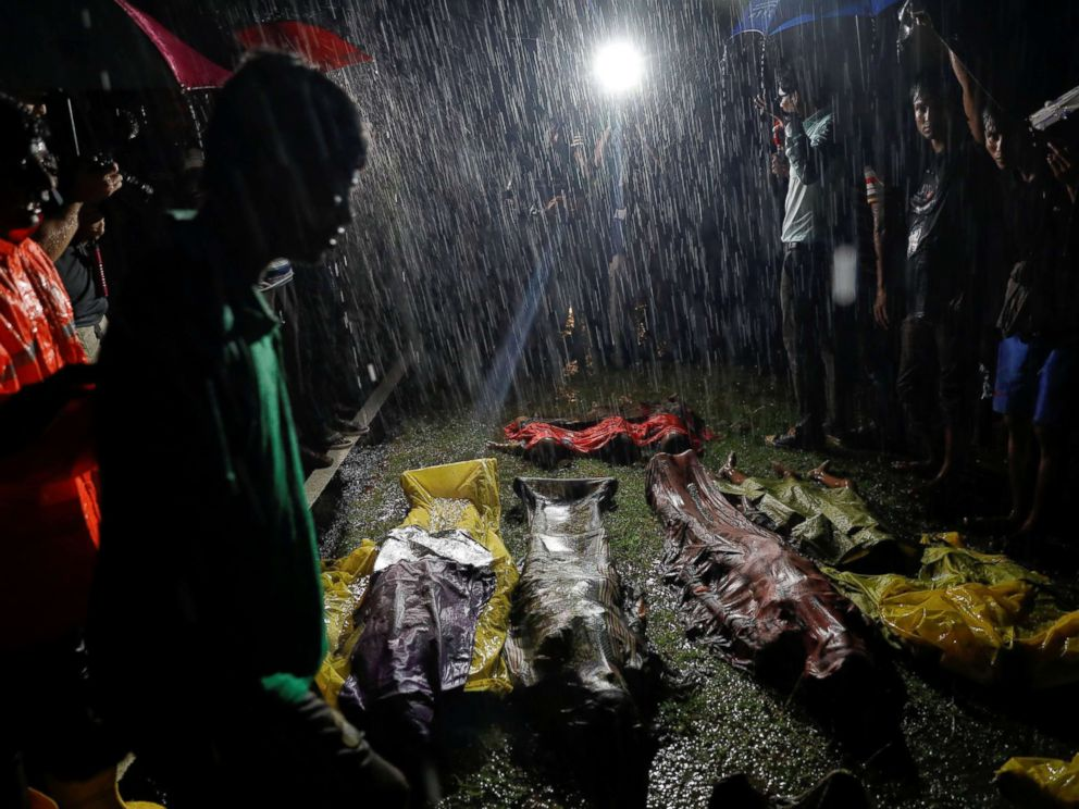 PHOTO: People gather in the rain around bodies of Rohingya refugees after their boat capsized off the Inani beach near Coxs Bazar, Bangladesh, Sept. 28, 2017.