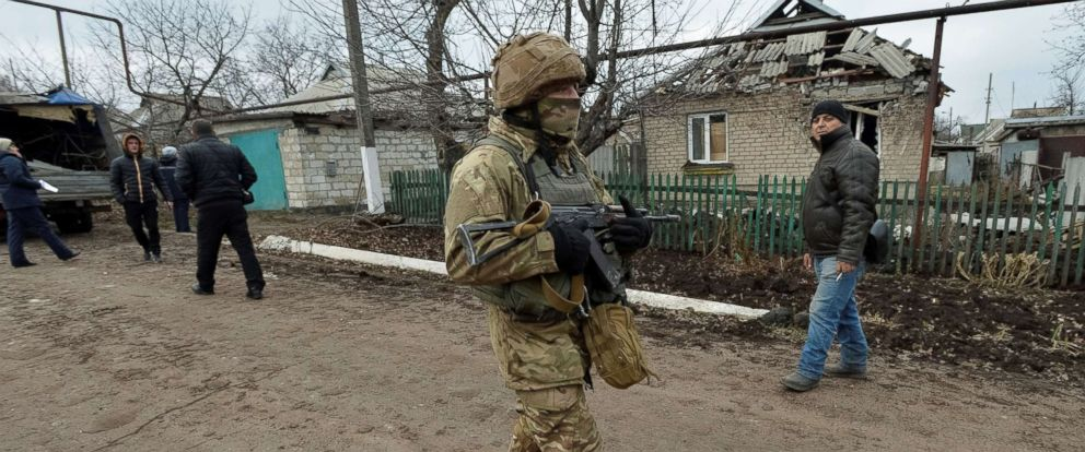 PHOTO: A Ukrainian serviceman patrols the area of a recent shelling in the government-held village of Novoluhanske, Ukraine, Dec. 19, 2017.