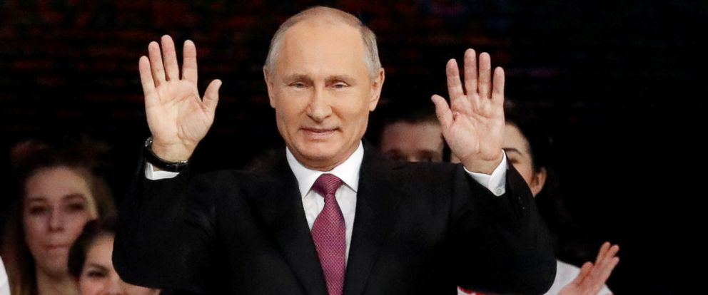 PHOTO: Russian President Vladimir Putin greets the audience at the congress of volunteers in Moscow, Dec. 6, 2017.