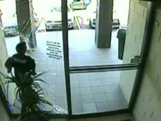 Watch: Purse-Snatcher Crashes Into Glass Door