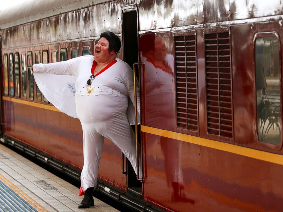PHOTO: Elvis Presley impersonator Sean Wright poses next to the Elvis Express train at Sydneys Central station before it departs for the 26th annual Elvis Festival being held in the New South Wales town of Parkes in Australia, Jan. 11, 2018.