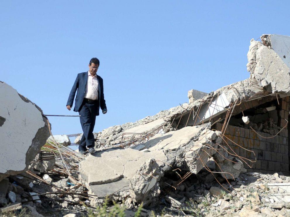PHOTO: A Yemeni teacher walks through the debris of a public school bombed by Saudi-led air strikes, on the first week of a new school year in Ibb, Yemen, Oct. 18, 2017.