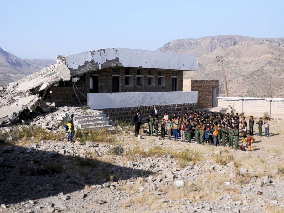 PHOTO: Yemeni students gather in lines for morning assembly on the first week of a new school year at a public school bombed by Saudi-led air strikes in Ibb, Yemen, Oct. 18, 2017.