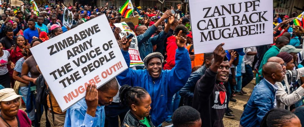 PHOTO: People carry placards during a demonstration demanding the resignation of Zimbabwe President Robert Mugabe, Nov. 18, 2017 in Harare.