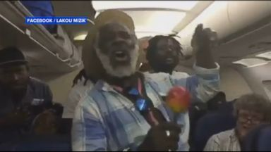 Band members of Lakou Mizik were among the passengers whose flight was delayed at Chicagos OHare airport. The Haitian band treated their fellow fliers with a now viral impromptu performance.