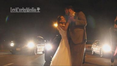 The couple was on their way to their reception when they got stuck on a highway.