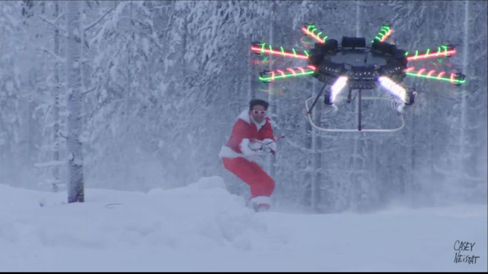ho ho snow santa snowboarder rides with drone video
