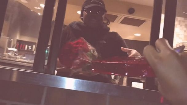 Man performs random act of kindness by giving flowers and chocolate to a Starbucks employee who doesn't have a valentine.