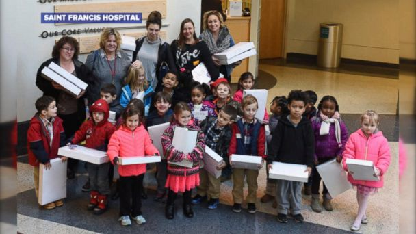 Teacher Gretchen Hertler McInvale and her students deliver boxes of baby necessities to Saint Francis Hospital and Medical Center in Hartford, Connecticut.