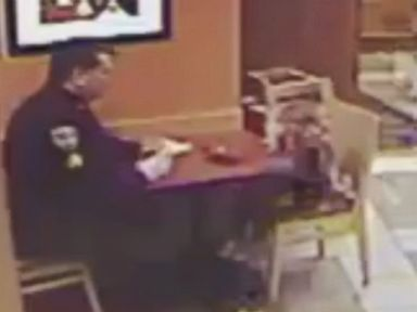 WATCH:  Police officer has adorable dinner date with girl