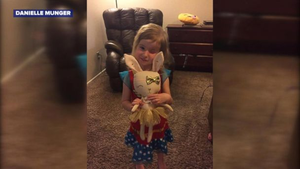 Little Brynn Munger, 3, was surprised for her birthday with a special one-eyed bunny doll to match her.
