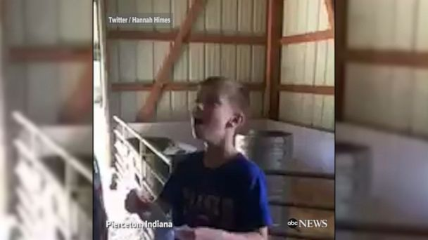 VIDEO: 9-year-old Chicago Cubs fan breaks down in tears when his father rewards him with tickets for his hard work on their family's farm.