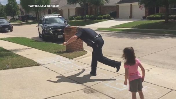 When the girl waved at the cop, he decided to hop into action and play a game of hopscotch with her.