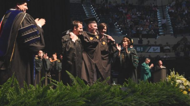 VIDEO: Sam Bridgman, 25, has a rare disease that causes nervous system damage and movement problems, but with some help, he stood up and walked at his University of South Florida Muma College of Business graduation ceremony.