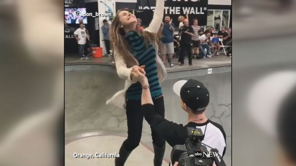 Professional skateboarder flies off of a halfpipe and drops to one knee to ask his long-time girlfriend to marry him.