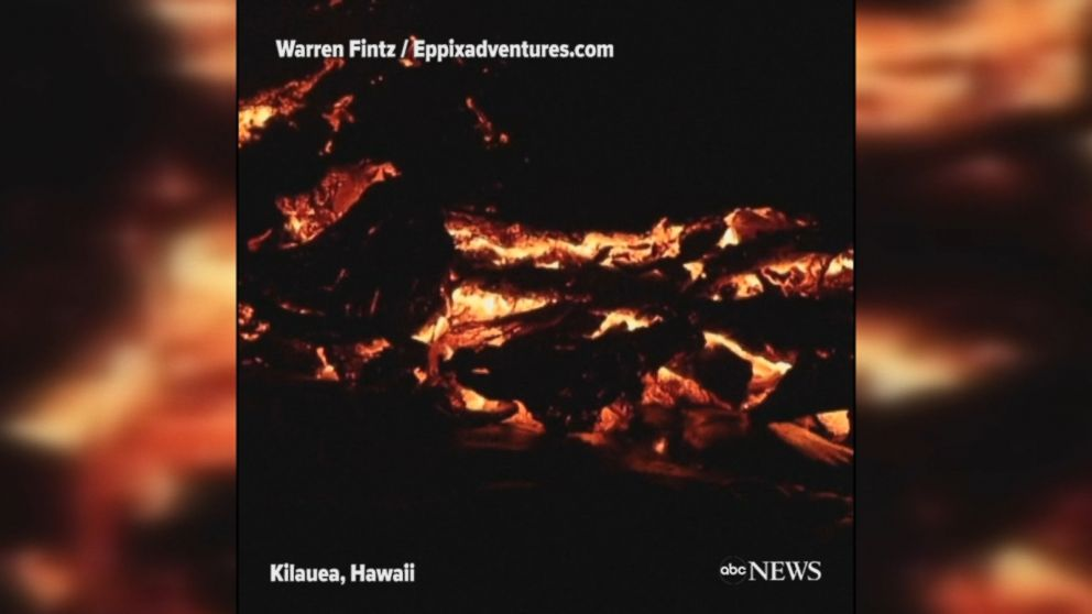 Mesmerizing footage shows lava lighting up the night as it flows down the extremely active Kilauea volcano in Hawaii.