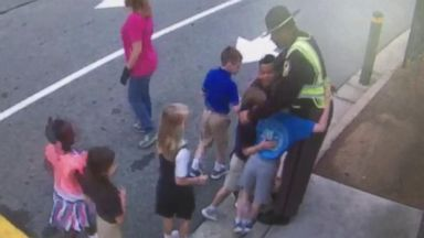 2nd-graders shower beloved security guard with hugs before summer