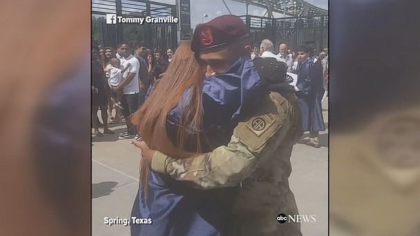 Teen jumps for joy as her brother, who is currently serving in the U.S. Army, surprises her at her high school graduation.