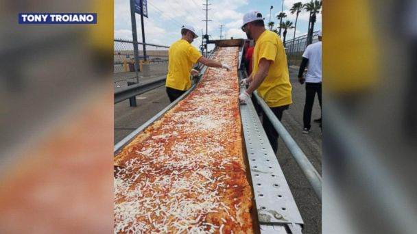VIDEO: Mile-long pizza breaks world record and helps feed the homeless