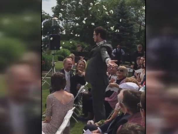 WATCH:  'Flower man' steals the show at cousin's wedding