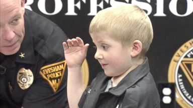 Child battling rare brain cancer becomes honorary cop for a day