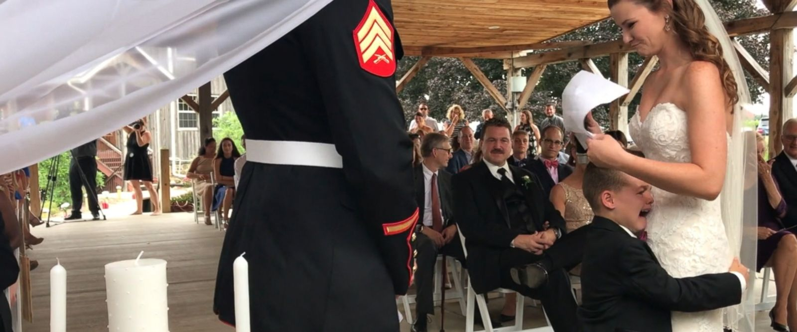 Senior Airman Emily Leehan recited heartfelt vows to her stepson Gage at her wedding, evoking tears and a close hug from the boy as they shared the emotional moment.