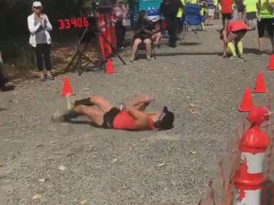 WATCH:  Determined marathoner rolls to finish line