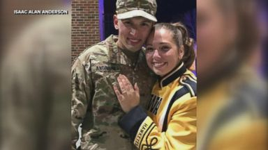 'Isaac Anderson surprised his longtime girlfriend, Grace Schebler, during her marching band performance1_b@b_1the University of Iowa football game on Oct. 28.' from the web at 'http://a.abcnews.com/images/Lifestyle/171103_vod_orig_bandproposal_mix_16x9_384.jpg'