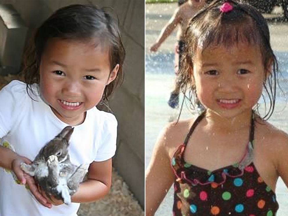 PHOTO: The two share a similar smile. Audrey Doering, pictured left at age 4, holds a bunny, and Gracie Rainsberry, pictured right at age 3, plays in a fountain.