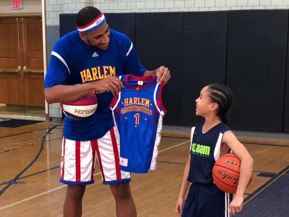 PHOTO: Karis also gained the attention of the Harlem Globetrotters, one of whom surprised her on the court today with her own personal jersey.