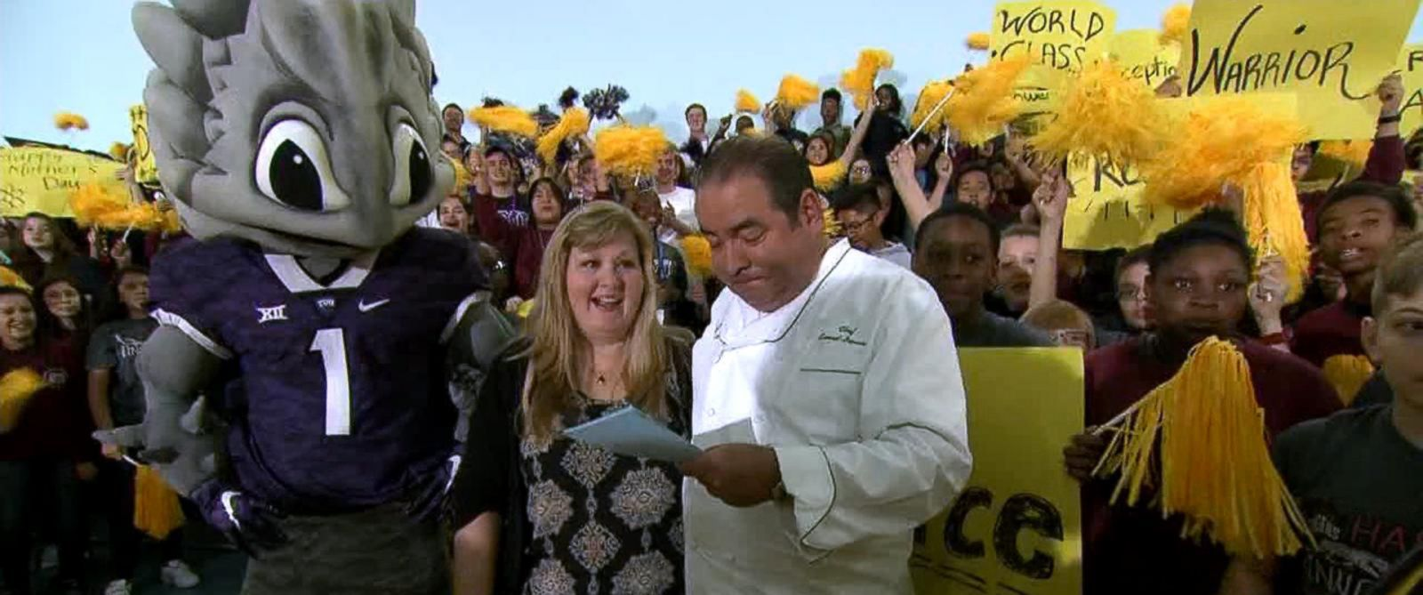 """PHOTO: Emeril Lagasse named Lea Siegel, an educator from Fort Worth, Texas, the winner of his annual """"Breakfast in Bed"""" search before leading her into the schools auditorium filled with students."""