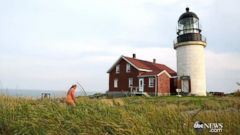 PHOTO: Caretaker Mitchell Thorpe mows the lawn of Seguin Island Light Station in Maine.