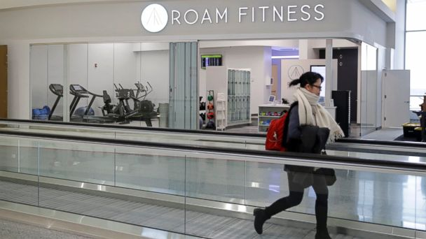 PHOTO: A traveler walks past the soon-to-be-open ROAM Fitness gym at Baltimore-Washington International Thurgood Marshall Airport, in Linthicum, Maryland, Jan. 30, 2017.
